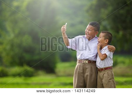 Happy child take a selfie in the cornfield asian