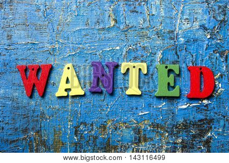 Wanted word written on colorful wooden abc latter.