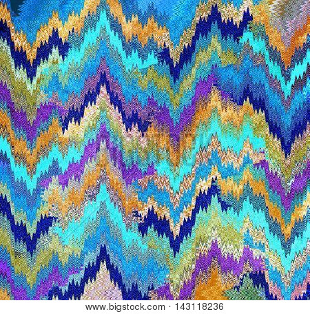 colorful fabric background with blue, yellow, purple and navy
