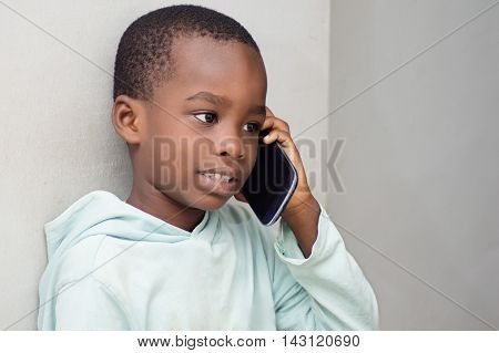 This child on the phone, listening intently his interlocutor.