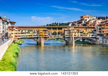 Florence Italy. River Arno and famous bridge Ponte Vecchio at sunset (Italian: Firenze Toscana).