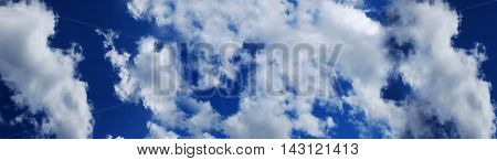 Background of blue sky and white clouds. Panorama of big sky with clouds.  The atmosphere of the firmament.