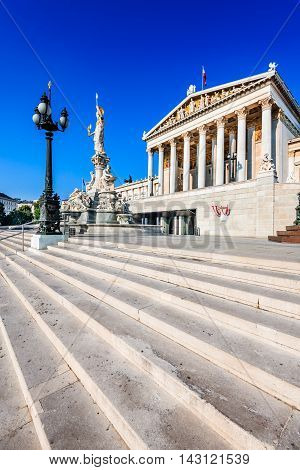 Panoramic view of Austrian parliament building with famous Pallas Athena fountain and main entrance in Vienna Austria
