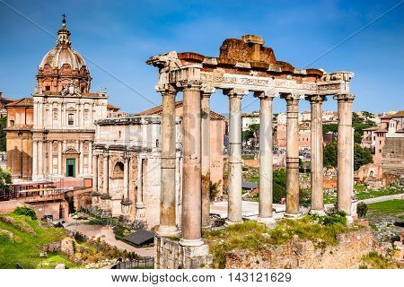 Rome Italy. Sunset view with ruins of Imperial Forum Roman Empire. Background with Colosseum (Colosseo or Coliseum).