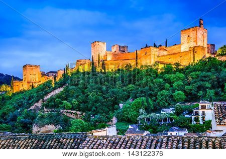 Granada Spain. Night View of famous Alhambra with Alcazaba European travel landmark in Andalusia.
