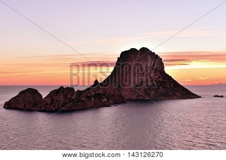 Es Vedra at sunset or sundown, tranquil scene. poster