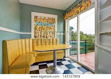 Classic Dining Room With Blue Walls And Exit To Balcony.