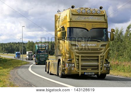 LEMPAALA, FINLAND - AUGUST 11, 2016: Berthons Scania Vikings V8 Longline 2016 moves along road as part of the truck convoy to the trucking event Power Truck Show 2016.