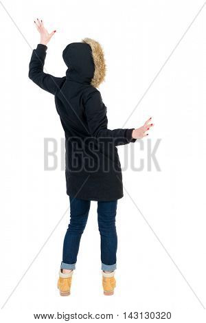 Back view woman in winter jacket  Balances waving his arms.   Standing young girl in parka. Rear view people collection.  backside view of person.  Isolated over white background. Girl in warm winter
