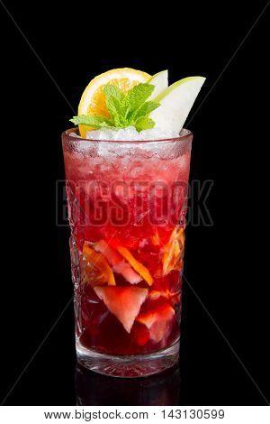 Cold sangria drink on a black background