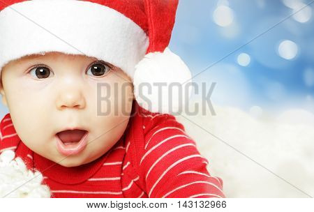 Surprised baby in Santa hat having fun Christmas and Happy New Year concept