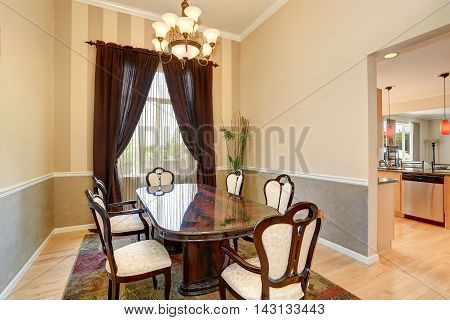 Dining Room Interior With Nice Table Set And Brown Curtains