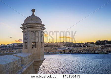 Malta - Watch tower and the walls of Valletta at Gardjola Gardens in Senglea at sunset