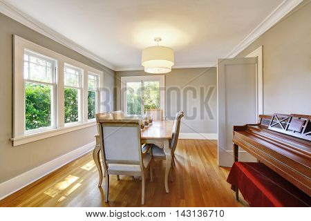 Open Floor Plan Dining Room With Table Set And Hardwood Floor.
