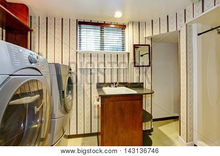 Old Style Laundry Room With Modern Appliances And Vintage Wallpaper.