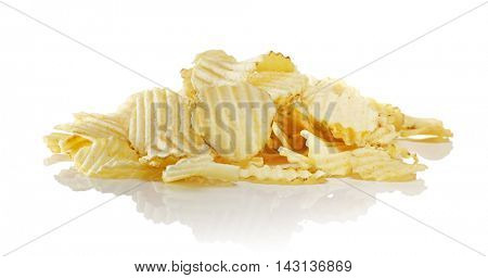 Heap of unflavored ridged potato chips on reflective surface.