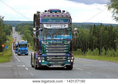 IKAALINEN, FINLAND - AUGUST 11, 2016: Colorful Scania R520 of Martin Pakos takes part in the ca. 420 km long truck convoy from the ports of Helsinki and Naantali to Alaharma to the annual trucking event Power Truck Show 2016 in Alaharma Finland.