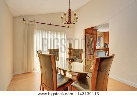 Dining Room Interior With Table Set. Glass Table And Leather Chairs.