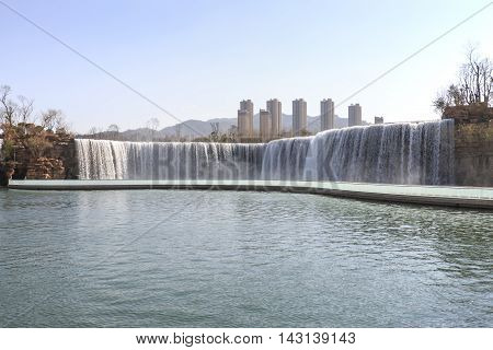 Kunming, China - March 4, 2016: Kunming Waterfall Park Featuring A 400 Meter Wide Manmade Waterfall.