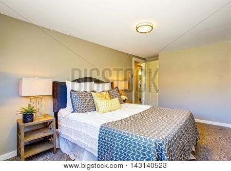 Small Bedroom Interior With Gray Walls And Carpet Floor.
