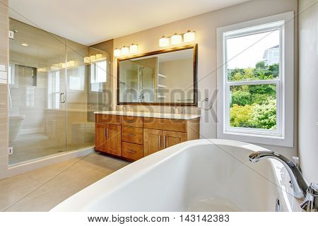 Bathroon  With Vanity Cabinet And Shower Area With Glass Doors