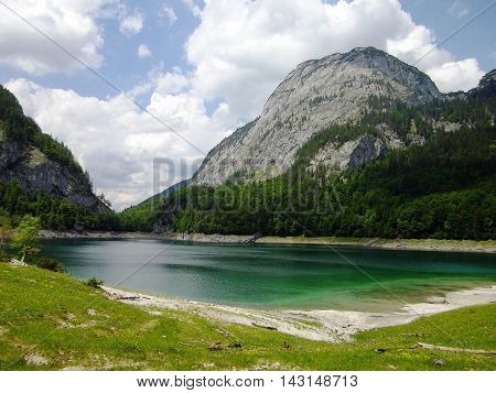 View Idyllic, beauty alpine landscape in Austria: lake, mountains, green grass, blue sky. Beautiful view on the Lake Gosau,  Salzkammergut region, Upper Austria, Austria, Europe