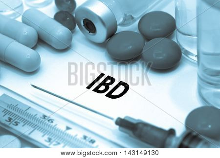 IBD (inflammatory bowel disease). Treatment and prevention of disease. Syringe and vaccine. Medical concept. Selective focus