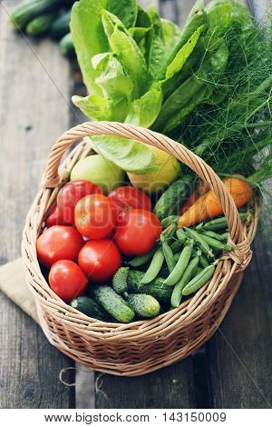 Healthy food background. photo of different vegetables in big basket