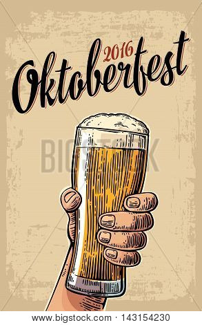 Male hand holding a beer glass. Vintage vector engraving illustration for web poster invitation to beer party time to drink. Isolated on beige background