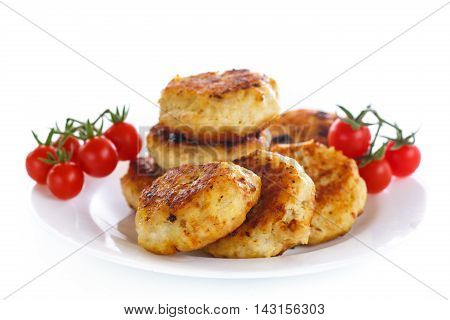 fried chicken cutlet with cherry tomatoes on a white background