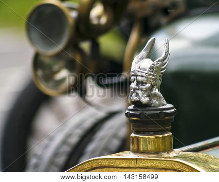 CONWY, WALES, JUNE 27. Bodnant Garden on June 27, 2016, near Conwy, Wales. A Chrome Viking Head Radiator Cap on a Vintage Rover Automobile at a car show at Bodnant Garden Wales.