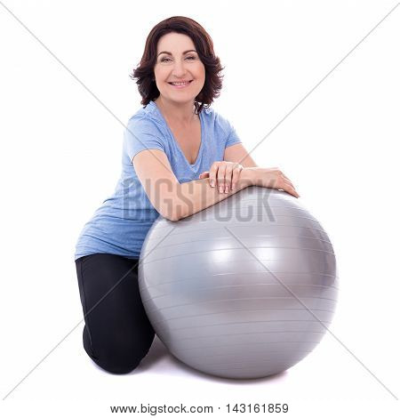 Happy Mature Woman Sitting With Fitness Ball Isolated On White