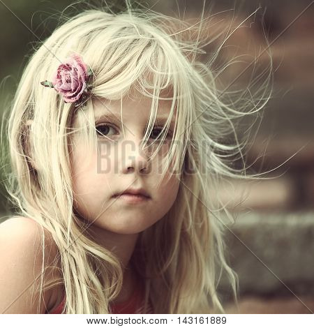Portrait of carefree beautiful child girl outdoors