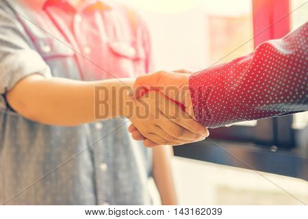 Business handshake and business people soft focus vintage tone