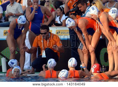 Budapest, Hungary - Jul 16, 2014. Netherland's HAVENGA Arno head coach talking about the tactics. The Waterpolo European Championship was held in Alfred Hajos Swimming Centre in 2014.