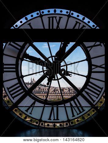 Paris France - August 26 2015: View through d'orsay museum clock tower of Sacre-Coeur Basilica Paris France