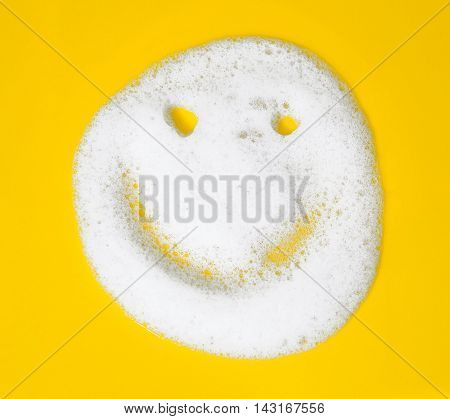 Smiley Of Soap Suds On Yellow Background