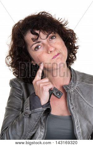 Lovely Brunette With Her Index Finger Poised On Her Cheek