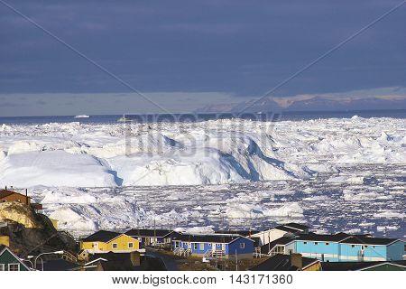 Greenland glacier glaciers houses ocean small town burg