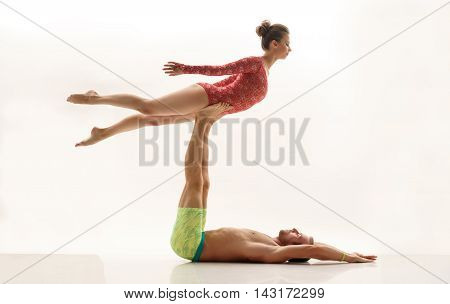 Duet of acrobats perform trick. Isolated on white background