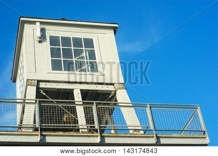 watch tower on blue sky gray building