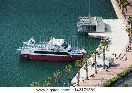 Alicante, Spain - SEPTEMBER 2015: Moored Touristic Boat in Alicante Marina