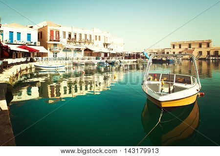 Yellow boat in Rethymnon impressions of Greece