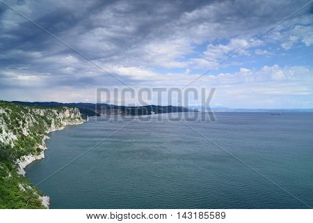 Beautiful cliffs on coast of Adriatic sea in gulf of Trieste Italy.