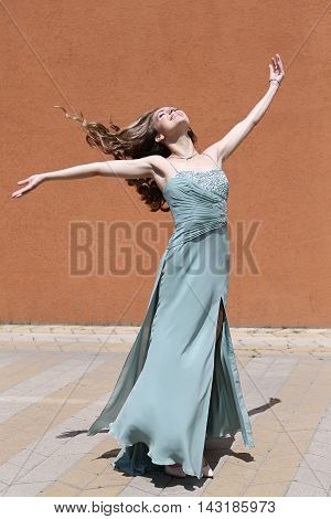 Happy woman with long brown hair in green dress