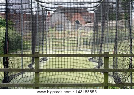 Cricket practice nets with artificial pitch in the UK