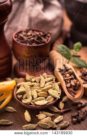 Clove and cardamom seasoning for beverages still-life
