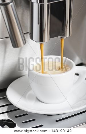 Coffee machine making a hot espresso cup