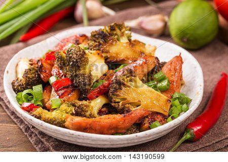 Crispy chilli chicken with brocolli on plate
