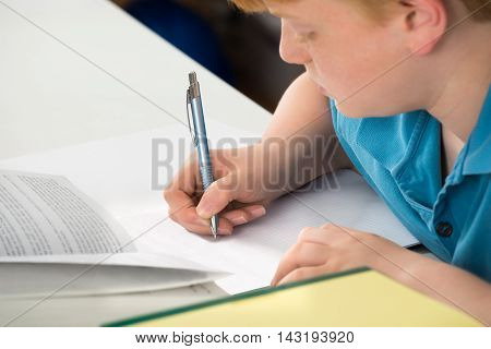 Close-up Of A Boy Doing His Homework
